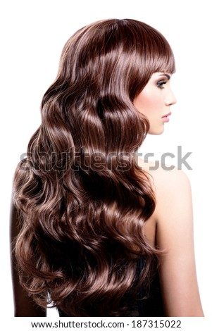 Profile portrait of a beautiful woman with brown curly hairs - isolated on white background. - stock photo