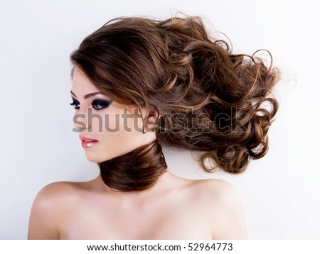 Profile Portrait of a beautiful  woman with  long curly hairs - stock photo
