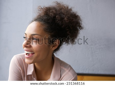 Profile portrait of a beautiful young african american woman laughing - stock photo