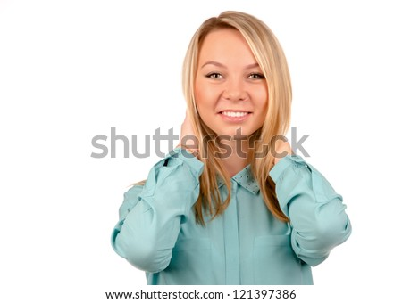 Profile portrait of a blonde female touching her hair. - stock photo