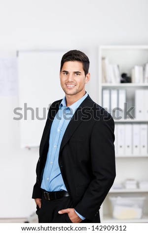 Profile portrait of a young well dressed businessman smiling for the camera. - stock photo