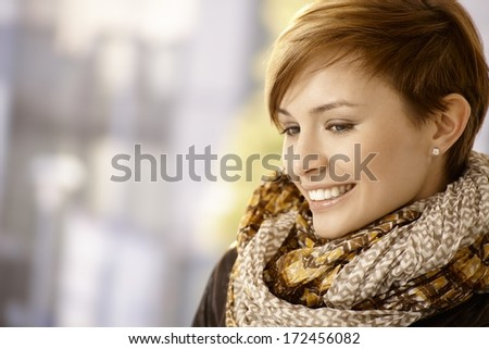 Profile portrait of attractive young woman with scarf - stock photo