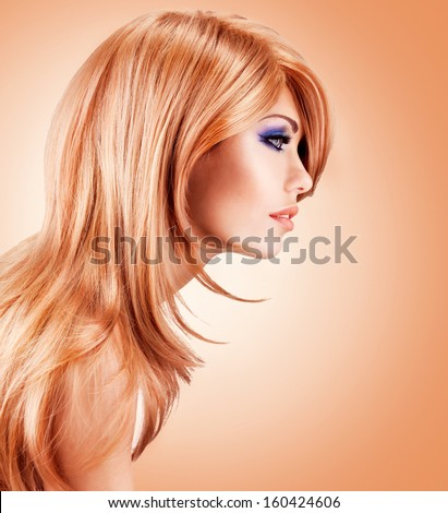 Profile portrait  of  beautiful pretty woman with long red hairs - posing at studio