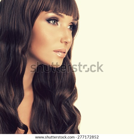Profile portrait  of beautiful woman with long red hairs. Closeup face  with curly hairstyle, isolated on white. - stock photo