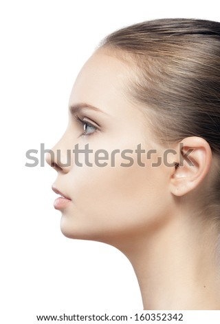 profile portrait of beautiful young woman with clean skin isolated on white background  - stock photo