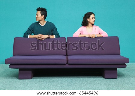 Profile portrait of couple behind couch