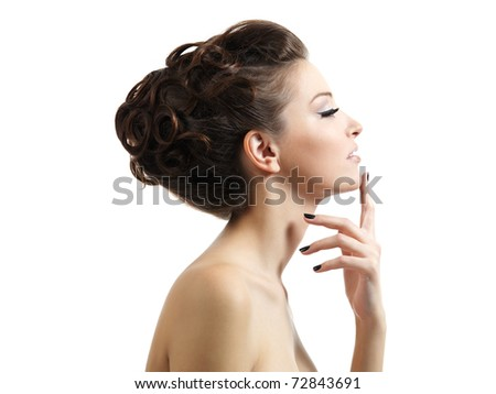 Profile portrait of the beautiful young girl with curly hairstyle -  isolated on white background - stock photo