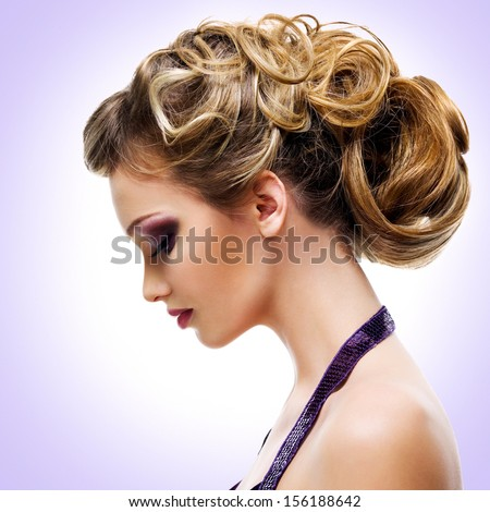 Profile portrait of  woman with fashion  hairstyle over creative background - stock photo