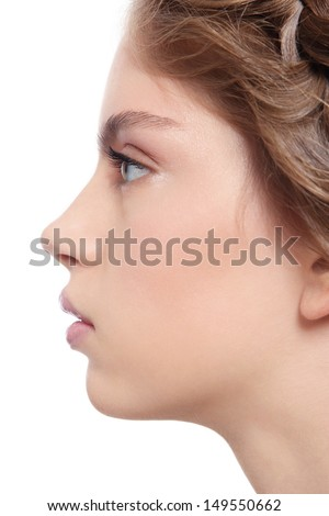 Profile portrait of young beautiful woman with clear make-up, over white background - stock photo