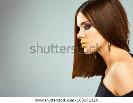 Profile portrait of young beautiful woman with straight hair. - stock photo