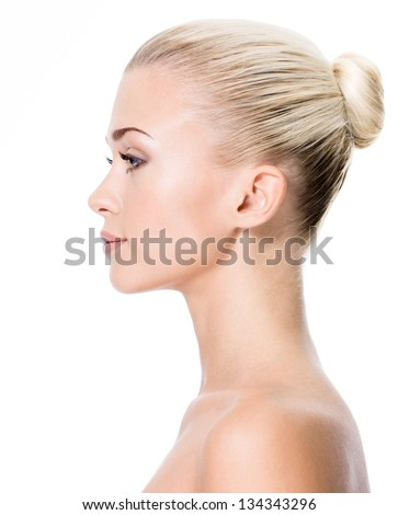 Profile portrait of  young blond woman - isolated - stock photo