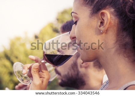 profile portrait of young couple toasts at sunset
