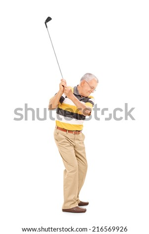 Profile shot of a senior swinging a golf club isolated on white background - stock photo