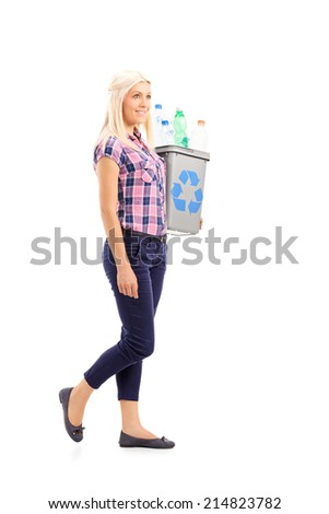 Profile shot of a woman carrying a recycle bin isolated on white background