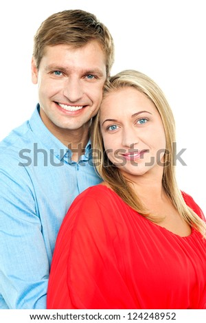 Profile shot of an adorable young love couple. Man hugging wife from behind - stock photo