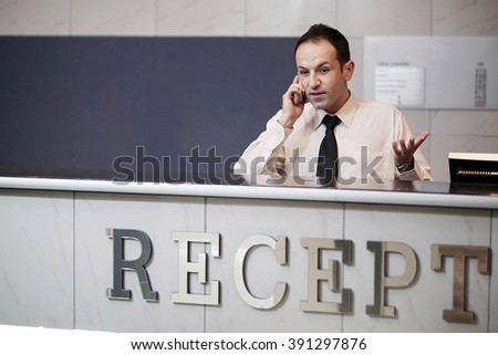 Profile shot of attractive executives at the reception of a hotel - stock photo