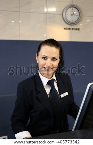 Profile shot of attractive executives at the reception of a hotel.  - stock photo