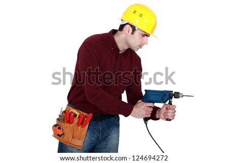 Profile shot of carpenter with power drill - stock photo