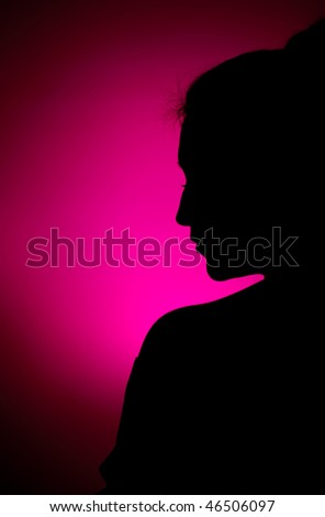 Profile silhouette of a young woman - stock photo