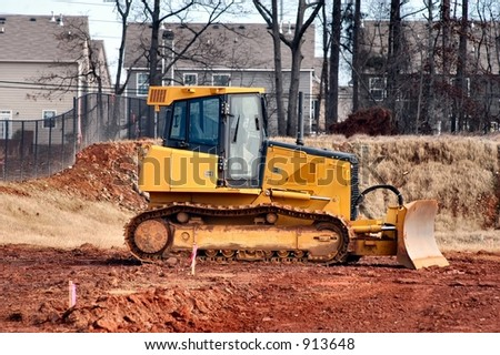 Profile view of a Bulldozer at a work site - stock photo