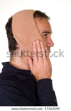 Profile view of a man wearing a bandage for his tooth pain