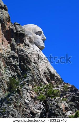 Profile view of Mount Rushmore National Memorial in the Black Hills of South Dakota - stock photo