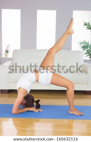 Sporty slim woman doing yoga pose stock photo 159921575 for Living room yoga