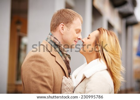 Profiles of attractive and affectionate dates in urban environment - stock photo