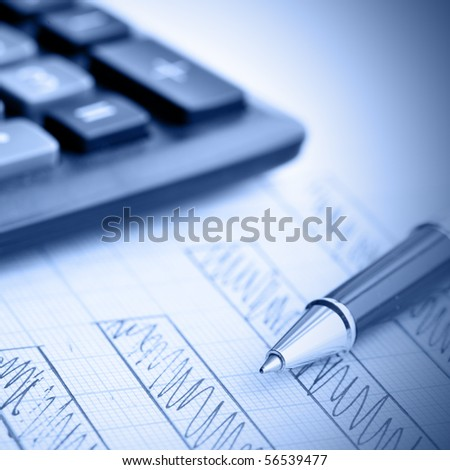 Profit bar chart, pen and calculator. Shallow DOF! Focus on the pen. - stock photo