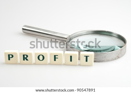 Profit word and magnifying glass