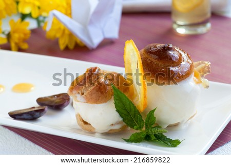 Profiteroles with ginger ice cream and lemon caramel - stock photo