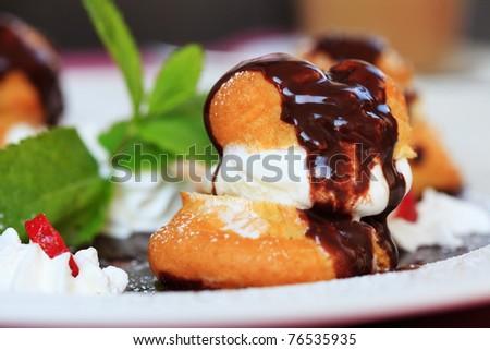 profiteroles with ice cream chocolate on plate - stock photo