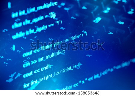 Program code and computer keyboard - stock photo