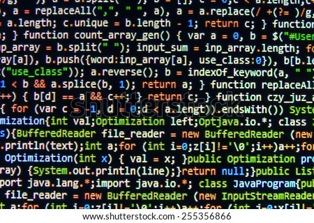 Program source code on monitor screen. Dark color. - stock photo