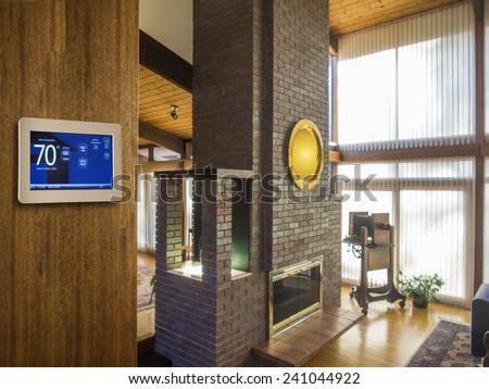 Programmable thermostat for temperature control in home - stock photo