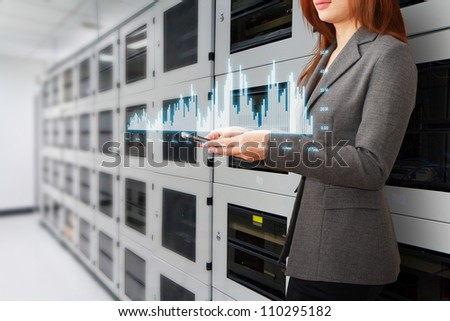 Programmer and graph monitor system in data center room - stock photo