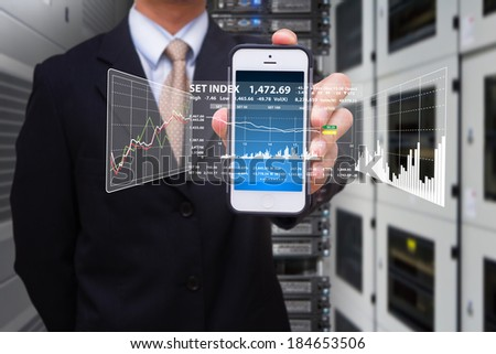 Programmer and smart phone in data center room - stock photo