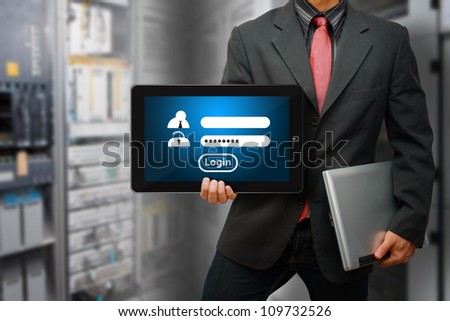 Programmer hold digital touch pad and Login user active - stock photo