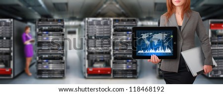 Programmer hold tablet in data center room