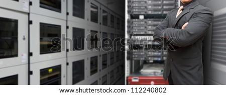 Programmer in data center room - stock photo