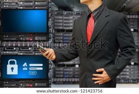 Programmer in data center room and Login screen activated for security - stock photo