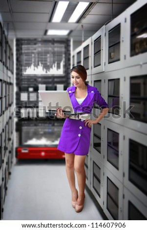 Programmer in data center room waiting for service - stock photo