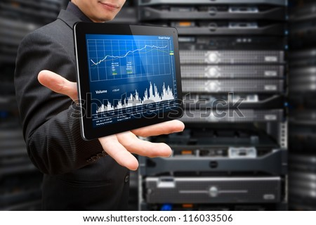 Programmer in data center room with graph monitor system - stock photo