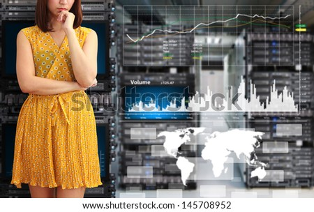 Programmer in data center room with graph report - stock photo