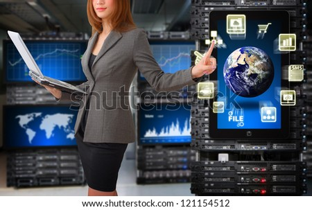Programmer take control the digital file in data center room  : Elements of this image furnished by NASA - stock photo