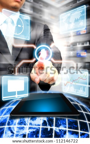 Programmer touch on power button to activate the system : Elements of this image furnished by NASA - stock photo
