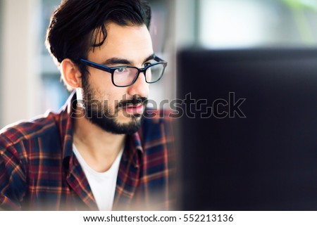 Programmer working at software development company office