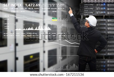 Programmers in data center room  - stock photo