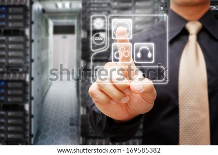 Programmers in data center room and press on power button - stock photo