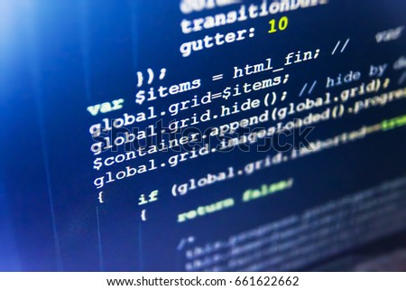 Programming code on computer screen. Computer code data. IT specialist workplace. WWW software development. Abstract source code background. Programmer typing new lines of HTML code.